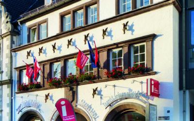 Geocoins auch bei der Tourist Info Paderborn